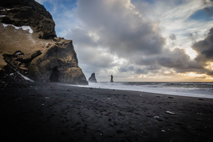 beach-black-sand-clouds-979591